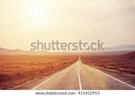 long road to mountains horizon. ...