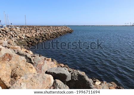Long Rock Levee at Coastal Community Landscape Stock fotó ©