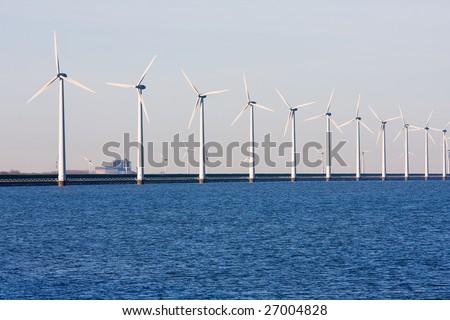 Long row of Dutch wind-turbines in the sea