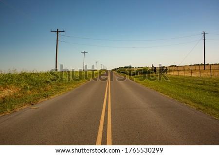Long Rural Road Through Farmland in Oklahoma Сток-фото ©