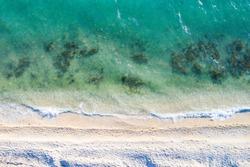 Long sand beaches on the island of Pag on Adriatic sea in Croatia, waves break on beautiful shore. Bird's eye, overhead view.