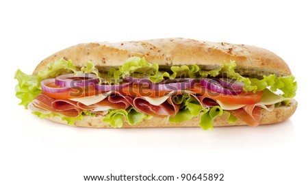 Long sandwich with ham, cheese, tomatoes, red onion and lettuce. Isolated on white. Another angle available