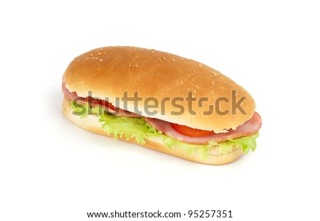 Long sandwich with ham, swiss cheese, lettuce and tomatoes isolated on white