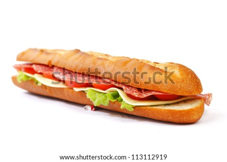 Long sandwich with  salami tomatoes isolated on white
