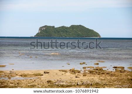 Long sandy beach. There front is an island called Khai island  #1076891942