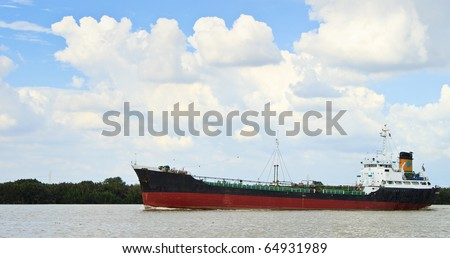 Long ship on a river with beautiful sky