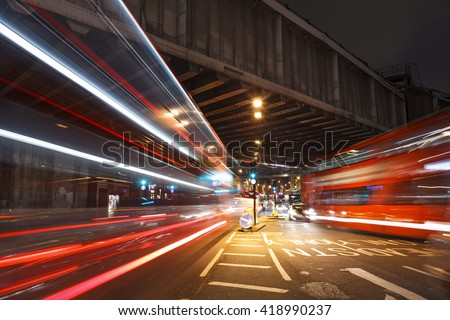 Photo of  Long shutter near to the London Bridge Station. Busy traffic under the railway bridge at night.