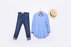 long sleeve blue shirt on hanging with blue jeans and hat