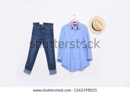 long sleeve blue shirt on hanging with blue jeans and hat   Stock fotó ©