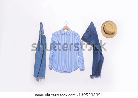 long sleeve blue stripy shirt on hanging and blue jeans with stripy on white background