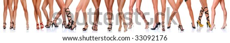 Long slim beautiful female feet in footwear, isolated on a white background, please see some of my other parts of a body images