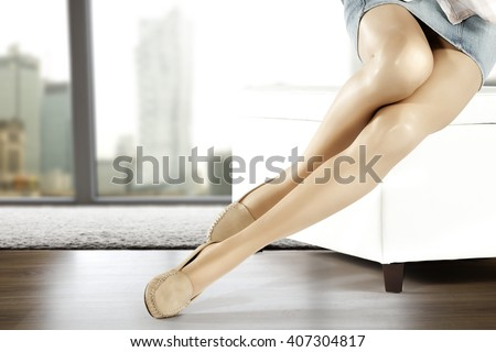 long slim woman legs brown shoes and window place