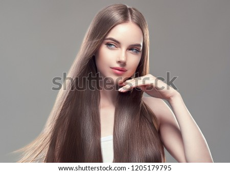 Long smooth hair healthy and beautiful woman with healthy skin cosmetic shampoo concept female model portrait #1205179795