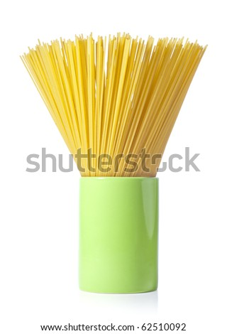 Long spaghetti in a green cup on white background. - stock photo