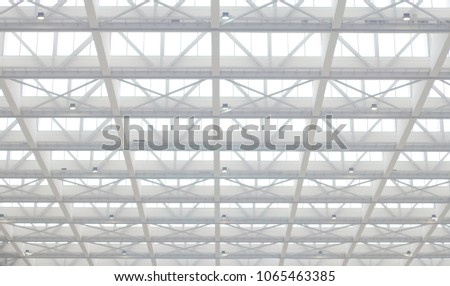 Long span roof structure with skylight in repetitive pattern. High key architectural background / wallpaper. #1065463385