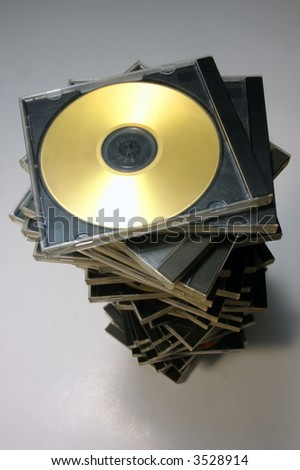 Long stack of classic CD/DVD case with golden disc from above