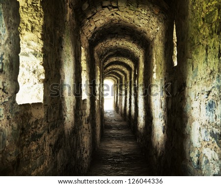 long stone corridor with windows in ancient castle