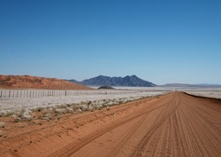 long straight road in Namibia. Kalahari Desert.  vast, expansive panorama