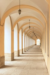 Long street gallery with arches, columns and lanterns