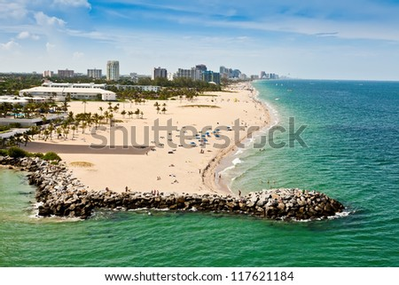 Long stretch of Ft. Lauderdale Beach in Florida with sandy beaches and numerous hotels and resorts.