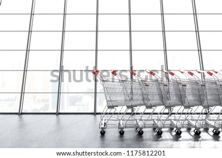 Long supermarket carts row standing along a panoramic window. Concept of marketing and consumerism. 3d rendering copy space