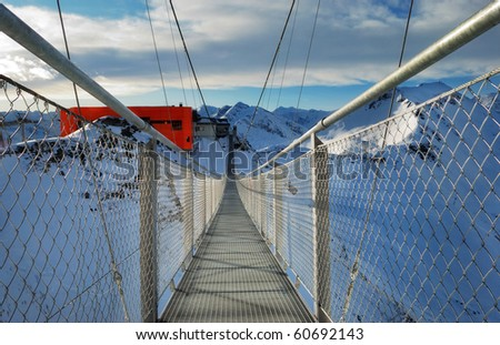 long suspension bridge high in the snowy alps
