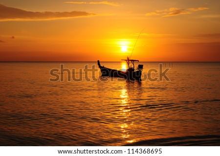 long tail boat and sunset Phangnga