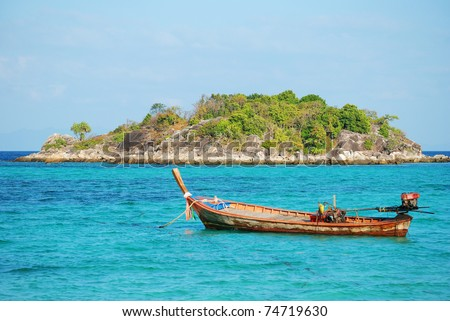 Long tail boat floating in Andaman sea