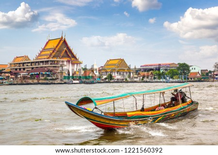 Long tail boat in Chao Phraya river in Bangkok, Thailand in a summer day