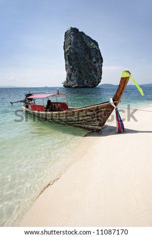 long tail boat on the seacost, krabi, thailand