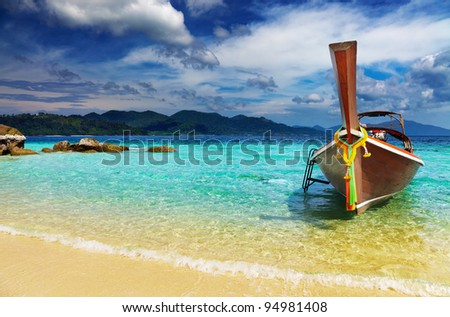 Long tail boat, Tropical beach, Andaman Sea, Thailand - stock photo