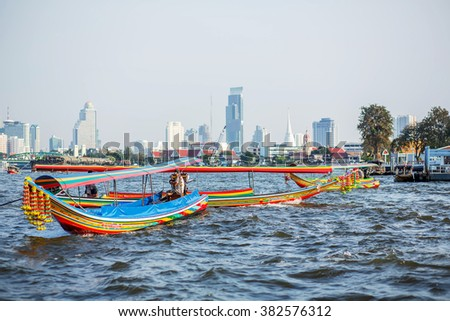 Long-tail boats in Chao Phraya river in Bangkok, Thailand. Image with selective focus