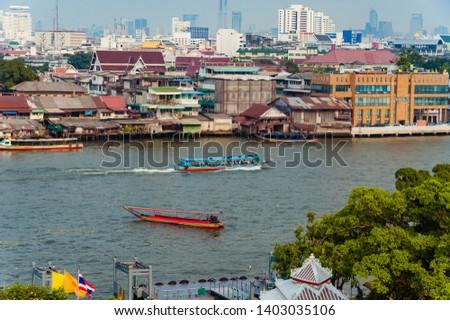 long tail boats on the river in Bangkok, cityscape of Bangkok #1403035106