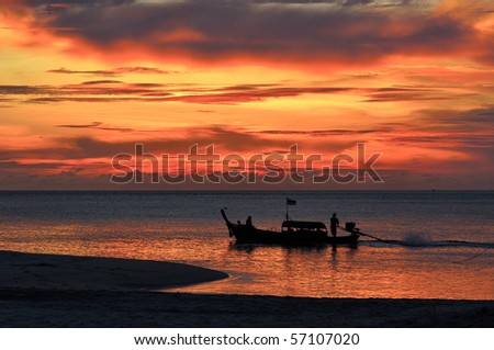 Long-tailed boat and sunset