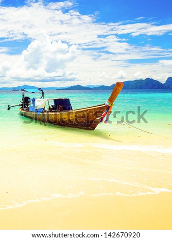 Long tailed boat at Kradan island, Thailand - stock photo