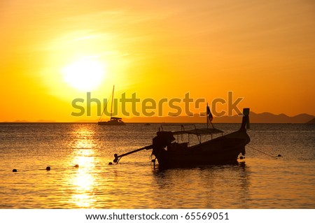 Long tailed boat at sunset , Ao Nang beach, south of Thailand