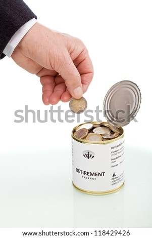Long term savings concept with senior hand and euro coins in tin can