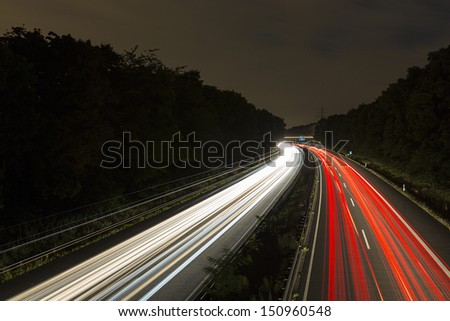 long time exposure on a highway with car light trails at night