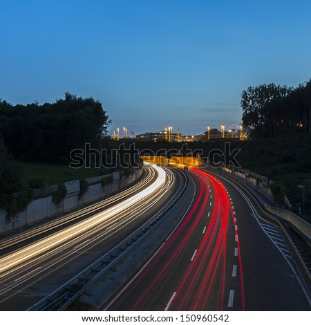 long time exposure on a highway with car light trails on blue hour