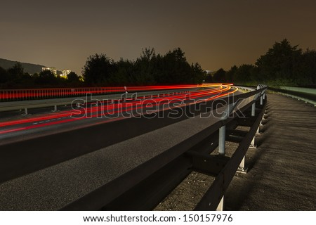 long time exposure on a roadway with car light trails