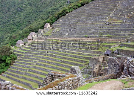 Long view of the extensive stone terraces at Machu Picchu, built by the Incas, centuries ago.