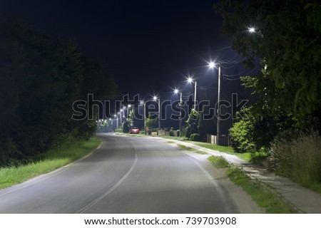 long village street with LED streetlights