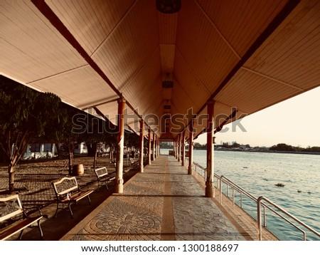 Long Waterfront Pavilion. Waterfront pavilion with waterfront stairs. Temple pavilion at North Bangkok Thailand. -image #1300188697