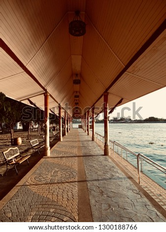 Long Waterfront Pavilion. Waterfront pavilion with waterfront stairs. Temple pavilion at North Bangkok Thailand. -image #1300188766