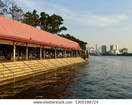 Long Waterfront Stairs. Waterfront pavilion with waterfront stairs. Temple pavilion at North Bangkok Thailand. -image #1300188724