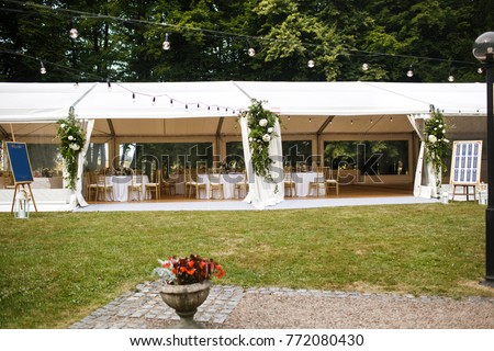 Long white tent for wedding party in the woods. #772080430
