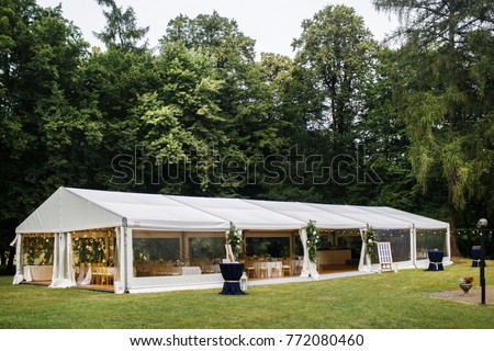 Long white tent for wedding party in the woods. #772080460