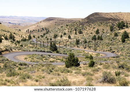 Long Winding Highway Along High Desert Farmland Landscape in Central Oregon