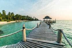Long wooden bridge pavilion in beautiful tropical island beach sunset - Koh Kood, Trat Thailand