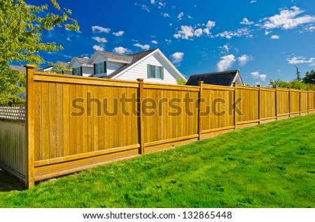Long wooden cedar fence. #132865448